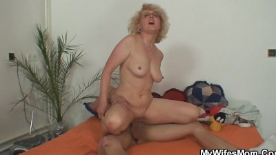 She finds her old mom riding her man's cock
