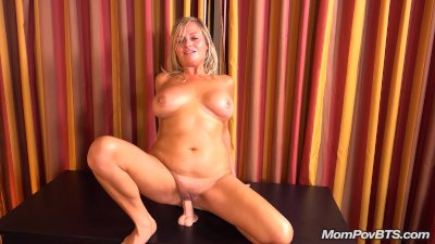 Busty blond MILF sucks and fucks new toy