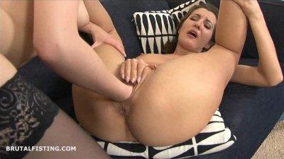 Brunette lesbian fisting her f