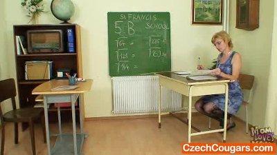 Dame teacher masturbates herse