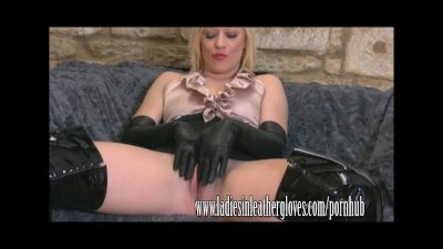 Hot blonde spreads her legs and plays with pussy in tight leather gloves