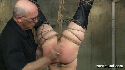 Bound slave suspended upside d