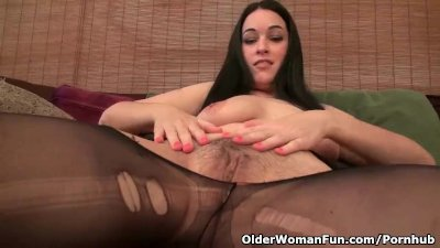 American milf Nyla Parker strips off and plays with her nyloned pussy