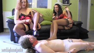 Milf femdoms turn sissy slave into high heel and fully fashioned nylon slut